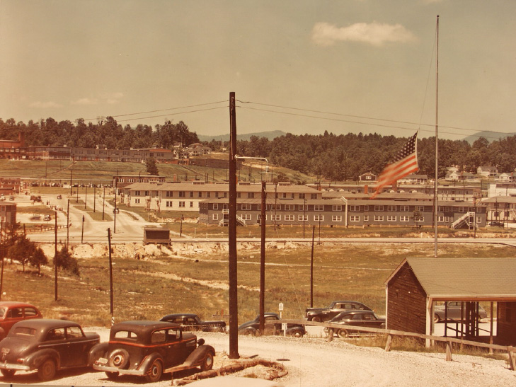 Barracks at Oak Ridge, fence visible in background.