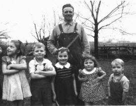 Stanley Addison Pemberton (in back with the ruler) and his children and his brother Wendell's children, ca 1940, White Bluffs. Photo courtesy of Our Hanford History.