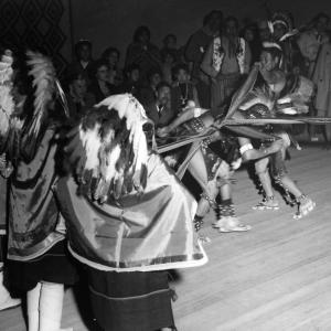 Pueblo dancers performing for Manhattan Project employees. Photo courtesy of the Robert JS Brown Collection.