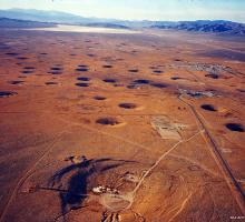 Test craters at the Nevada Test Site. Image courtesy of Los Alamos National Laboratory Archives.